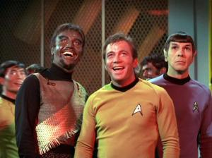 Kirk laughs with McCoy and Kang, and the alien eventually departs.