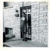 Mom standing by the front door