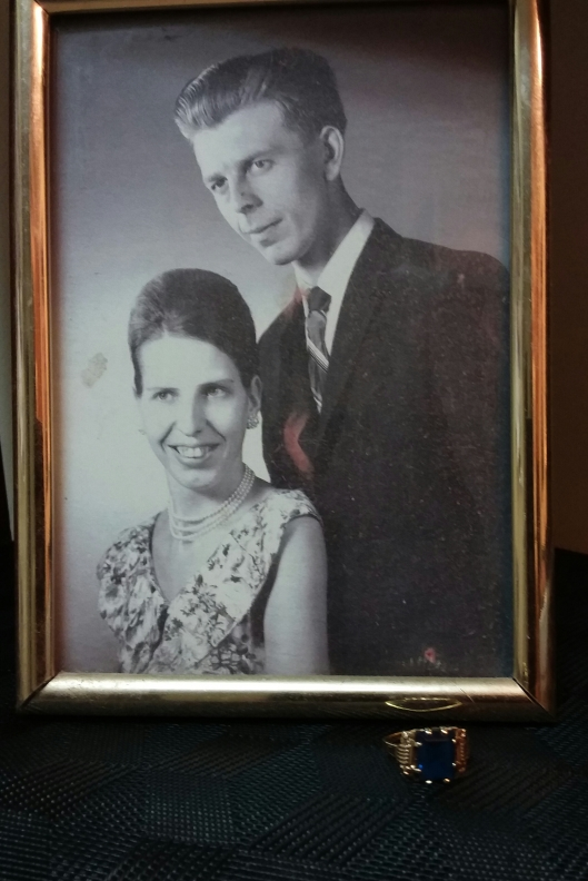 My parents in 1960 and the ring with the blue stone